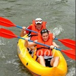 """Andrea and Steve showing them how to paddle! Photo """"Borrowed"""" from: Hudson Photographic"""